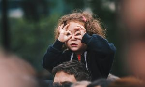 girl making hand gesture on her face